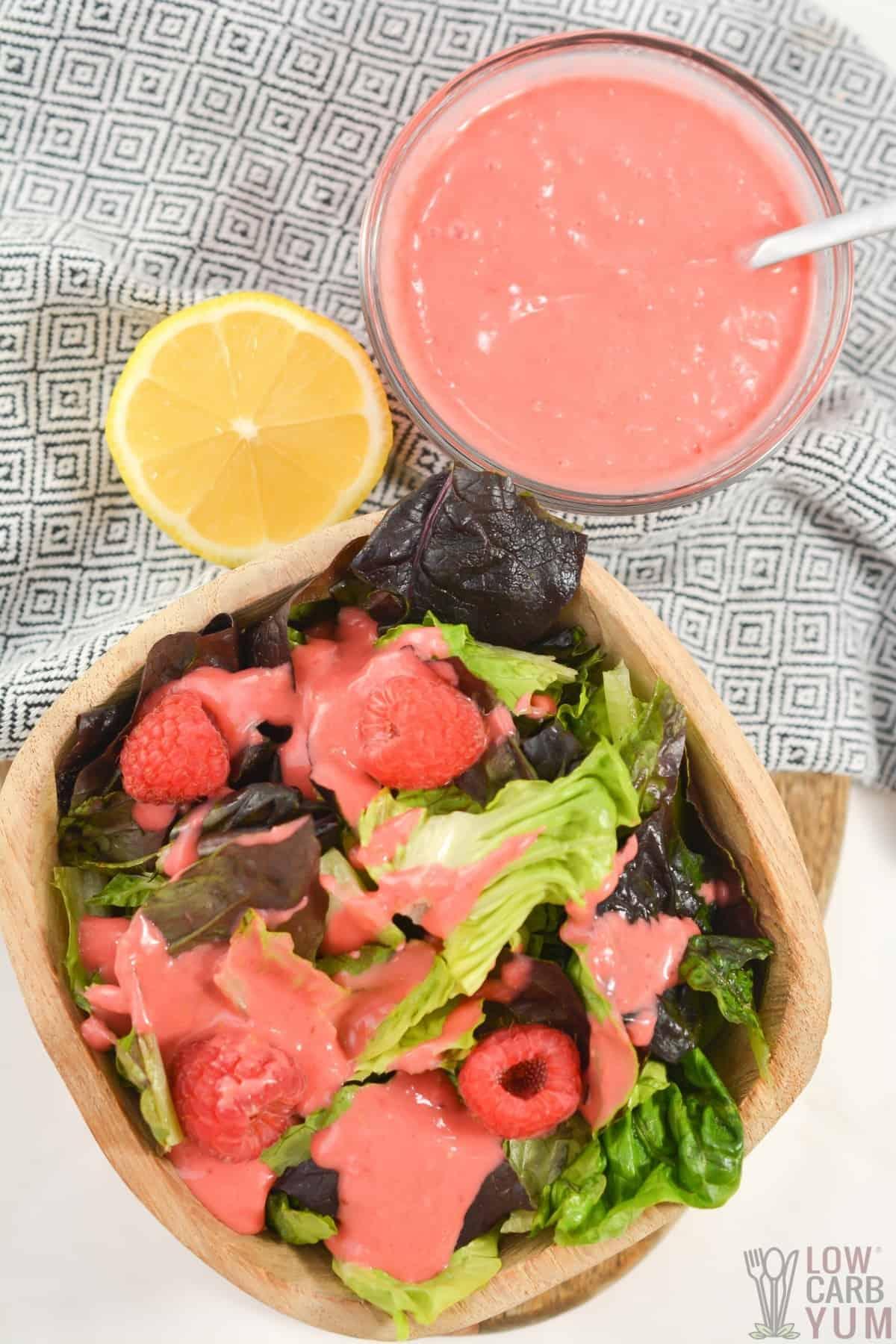 raspberry vinaigrette dresing drizzled over salad