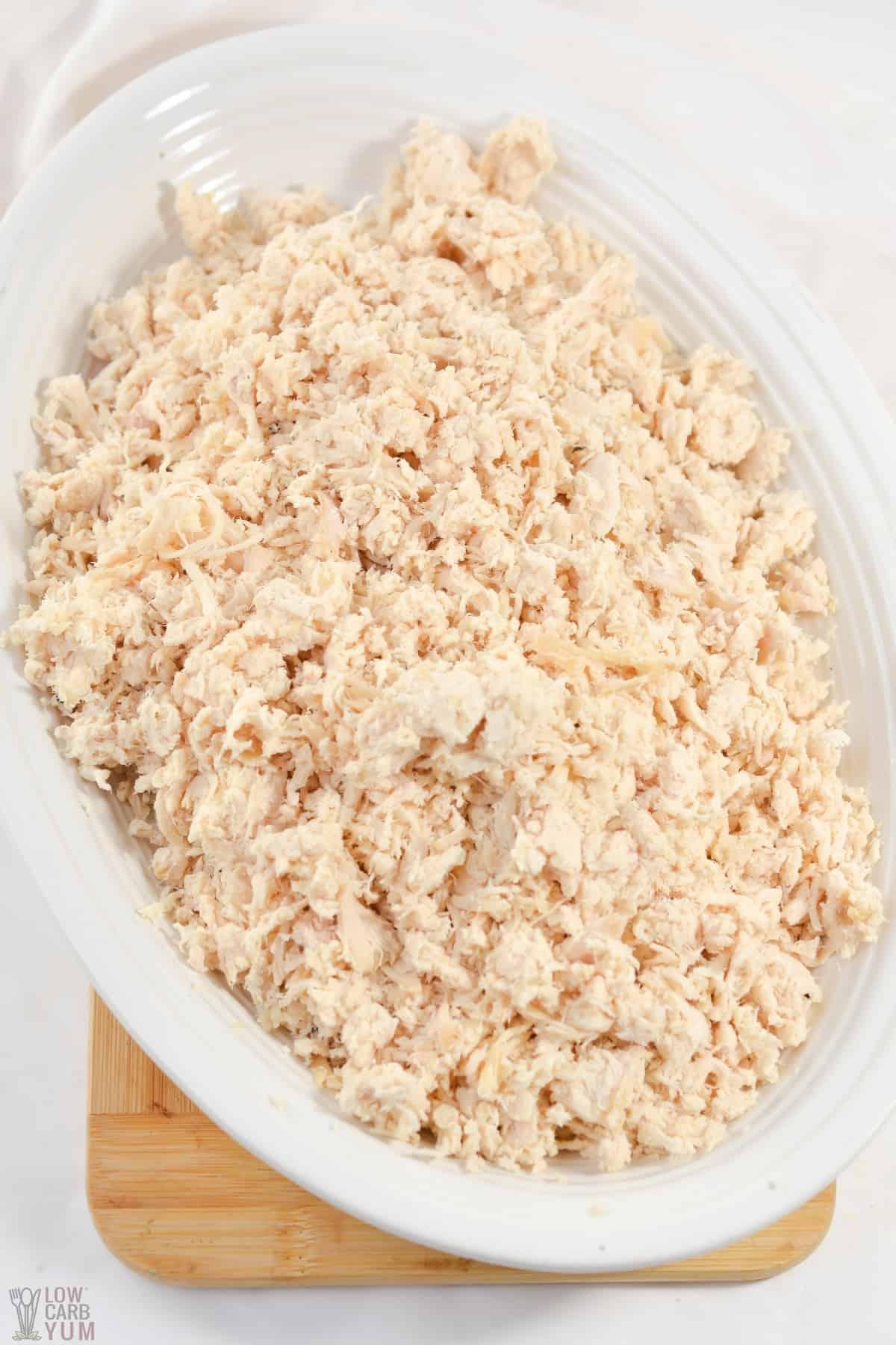 crockpot shredded chicken on white platter