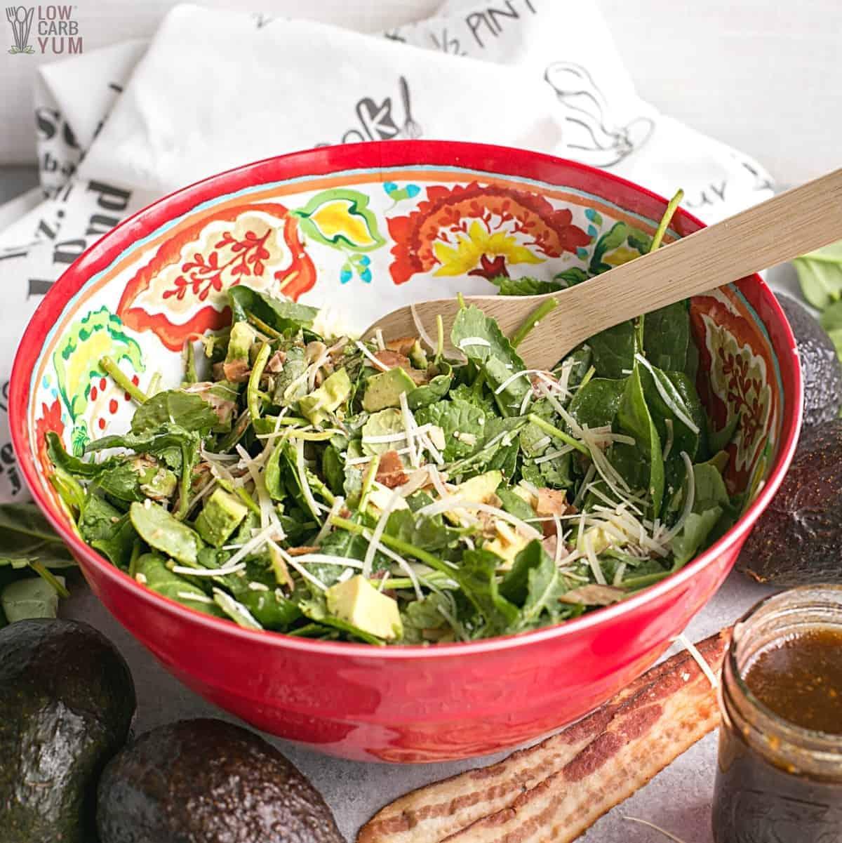 baby kale avocado salad mixed in large bowl