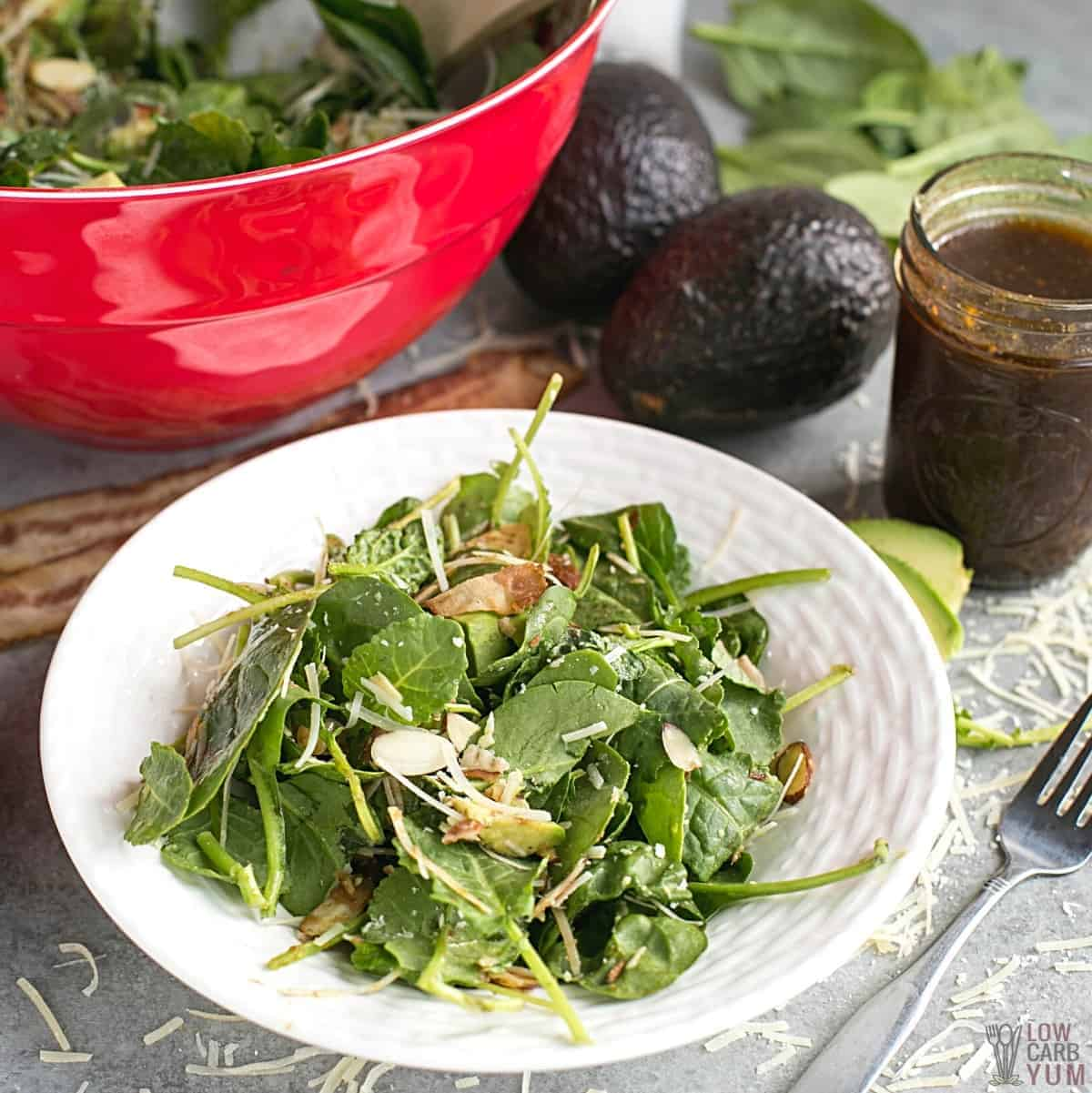 baby kale avocado salad on serving plate