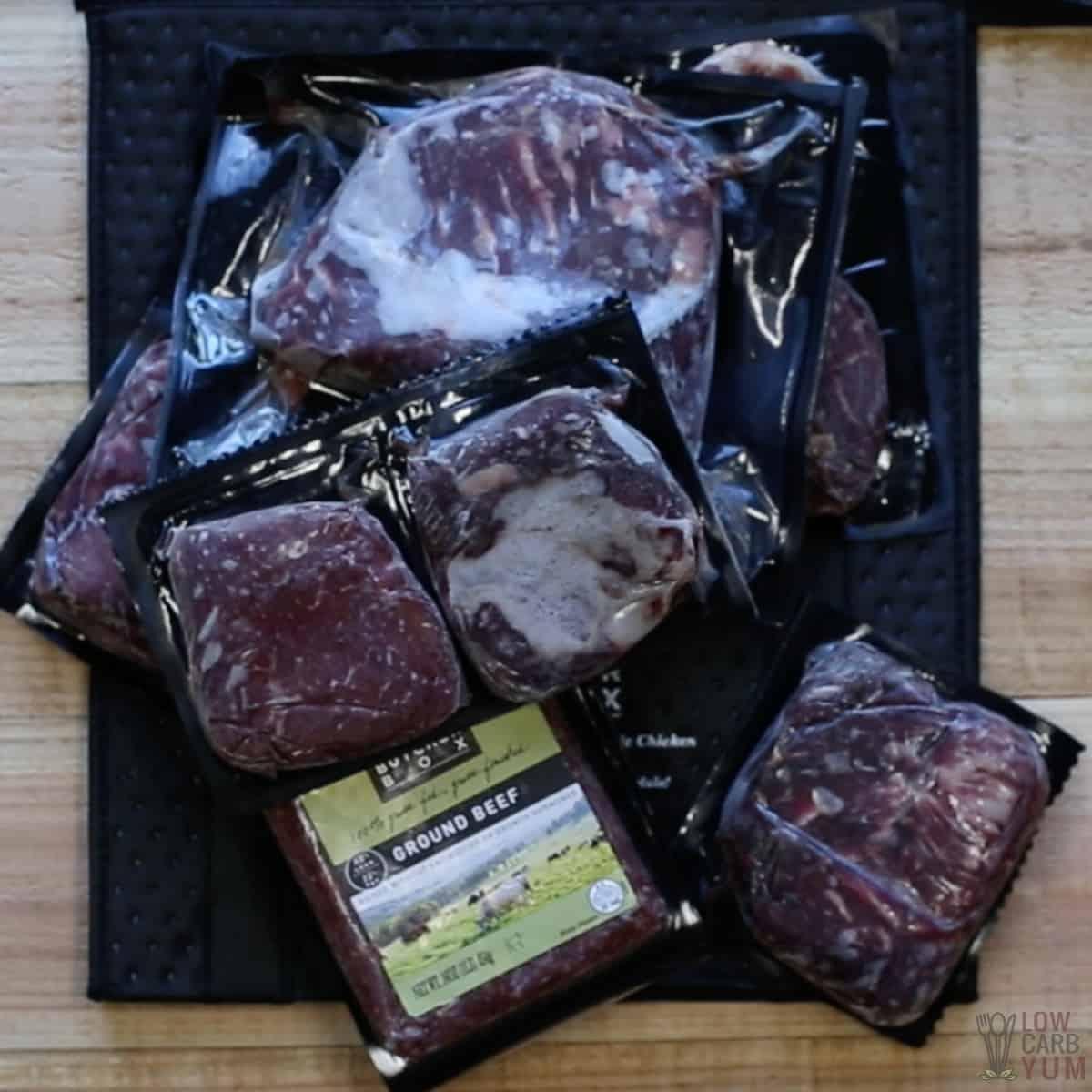 butcher box meats over black cooler bag