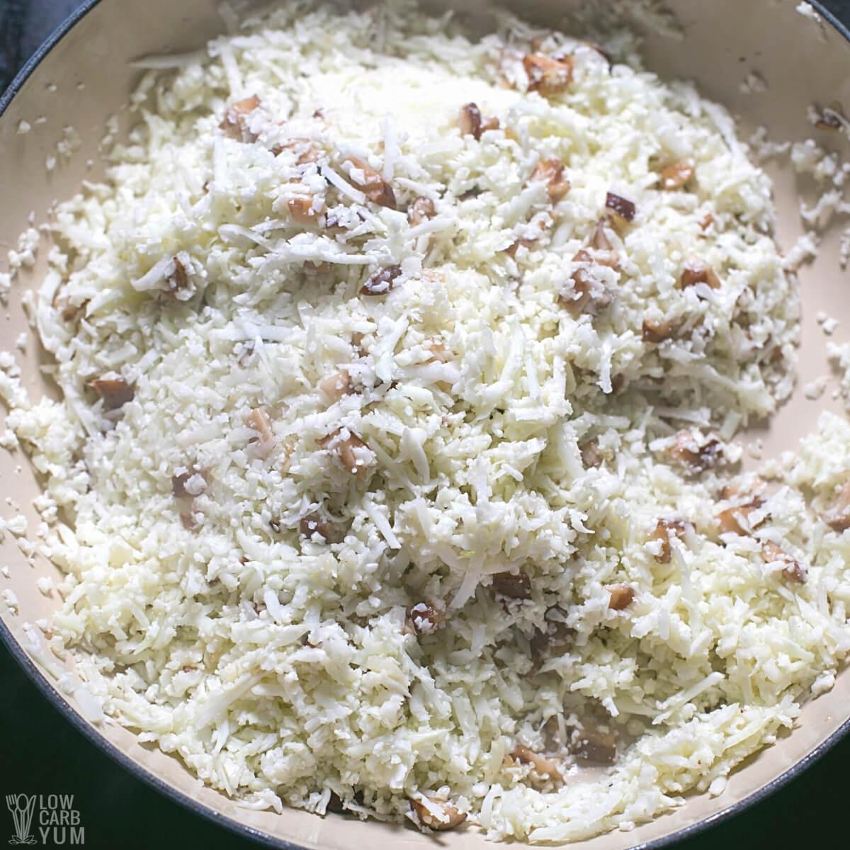 cauliflower rice and mushrooms in pan