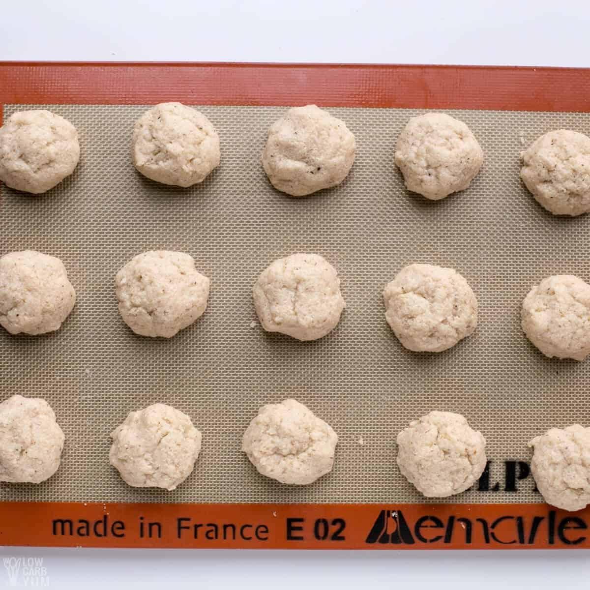 rolled bun dough on lined baking sheet