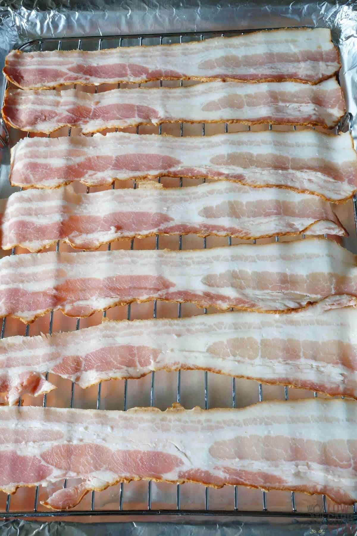 raw bacon on rack
