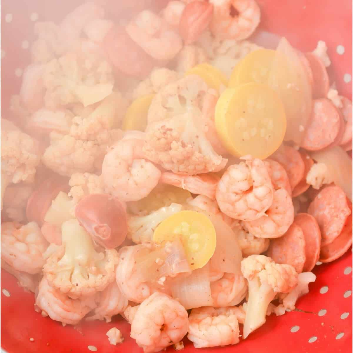 draining the shrimp boil after cooking