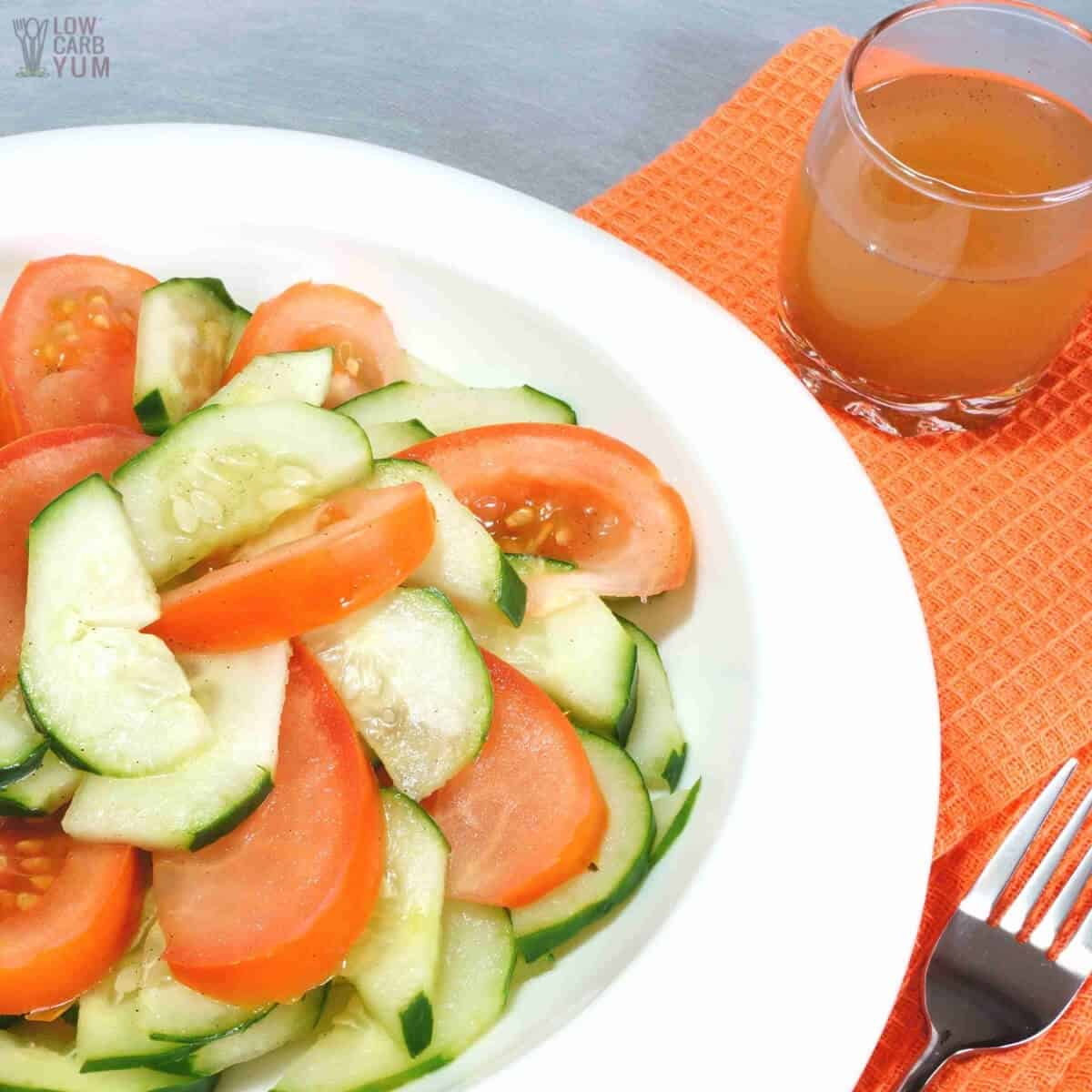 serving cucumber tomato salad with dressing