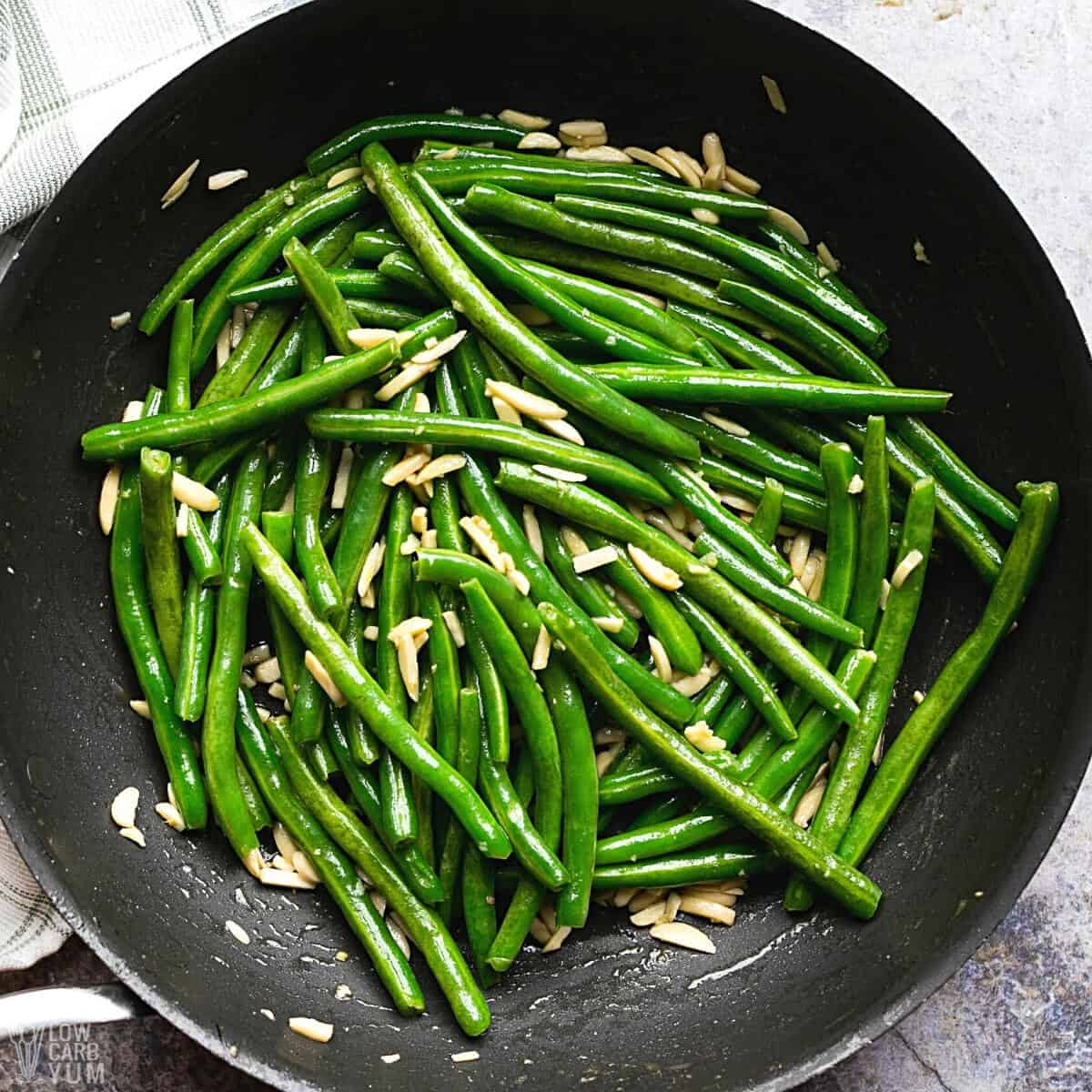 green beans almondine cooked in skillet