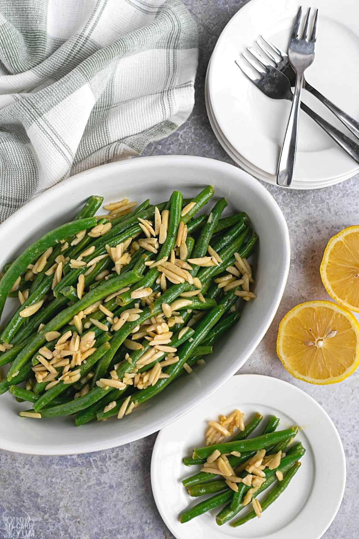 green beans almondine recipe served on white plate
