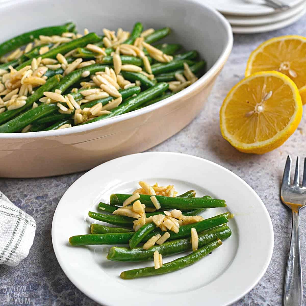 serving green beans almondine on white plate