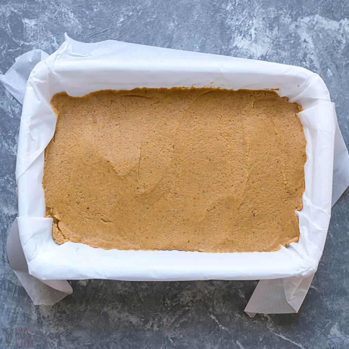 pumpkin fudge mixture spread into lined baking pan